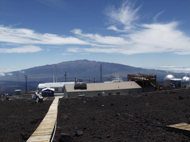 NOAA's Mauna Loa Observatory in Hawaii. Thursday, levels of the greenhouse gas carbon dioxide at Mauna Loa surpassed 400 parts per million for the first time since measurements began in 1958. Pre-industrial carbon dioxide levels were 280 parts per million. Mauna Kea is in the background. (Credit: NOAA photo)